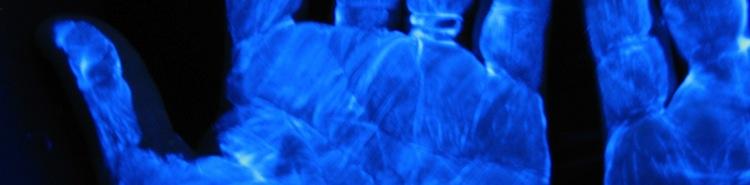 Unwashed hands under UV light
